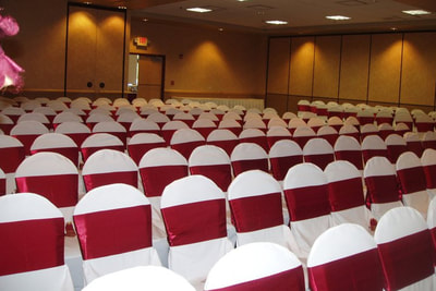 Ceremony with white chair cover burgundy sash